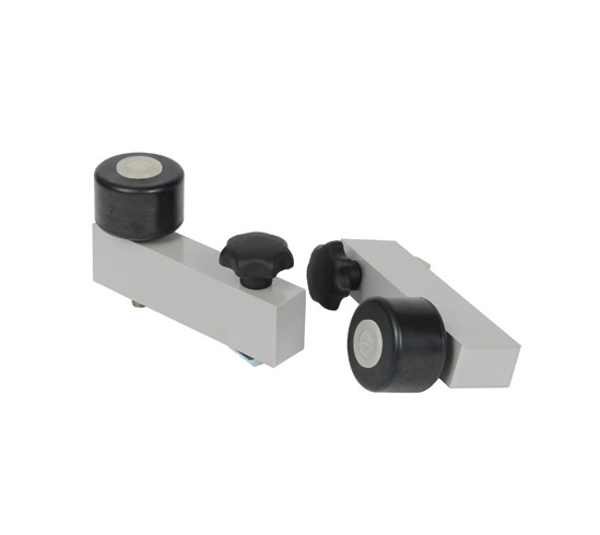 Stopper rollers for grinding circular panes